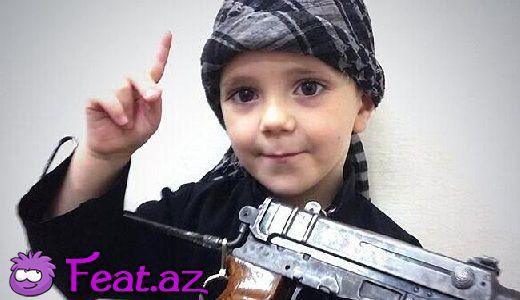 İŞİD terrorçusu kəsilmiş başı körpə oğluna verdi - VİDEO